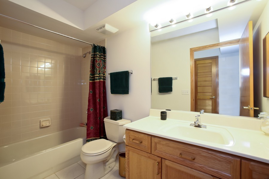 Real Estate Photography - 100 N Gary Ave, Unit 409, Wheaton, IL, 60187 - Hall Bath