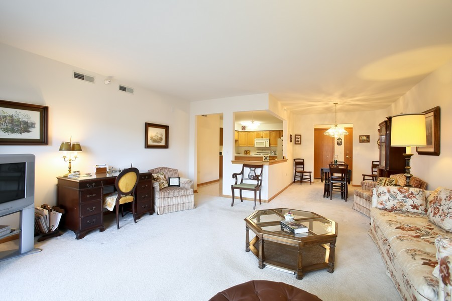 Real Estate Photography - 100 N Gary Ave, Unit 409, Wheaton, IL, 60187 - Living Room / Dining Room
