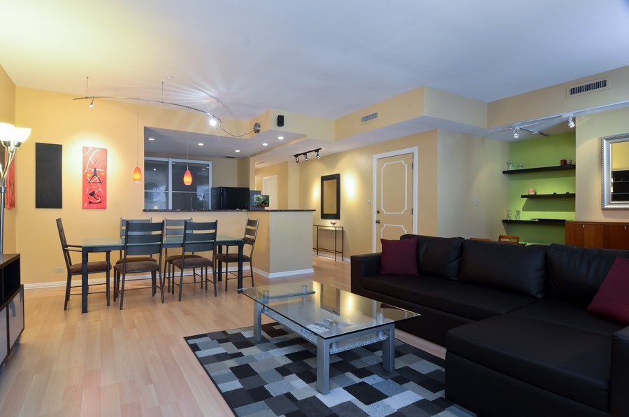 Real Estate Photography - 509 West Roscoe St, 2E, Chicago, IL, 60657 - Living Room / Dining Room