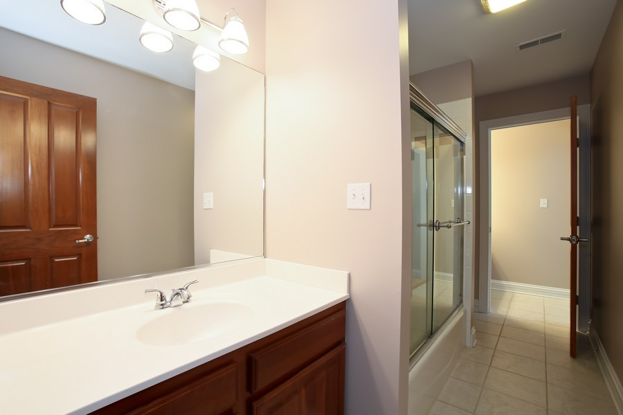 Real Estate Photography - 4712 Seeley AVE, Downers Grove, IL, 60515 - 2nd Floor Hall Bath with access to Bedroom