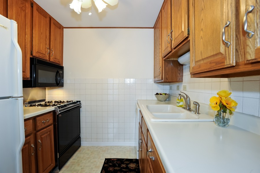 Real Estate Photography - 1105 Royal St George Dr, 101, Naperville, IL, 60563 - Kitchen