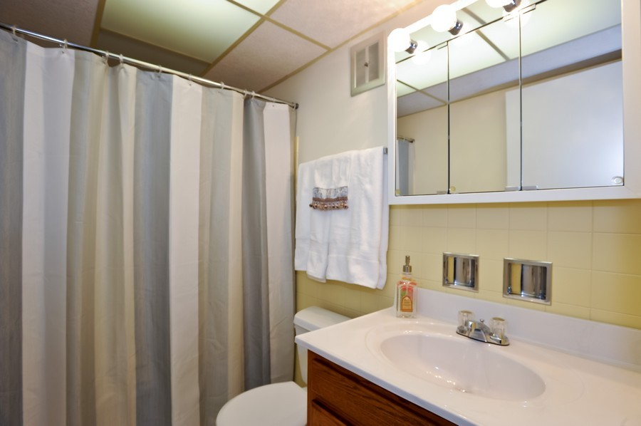 Real Estate Photography - 1105 Royal St George Dr, 101, Naperville, IL, 60563 - Bathroom