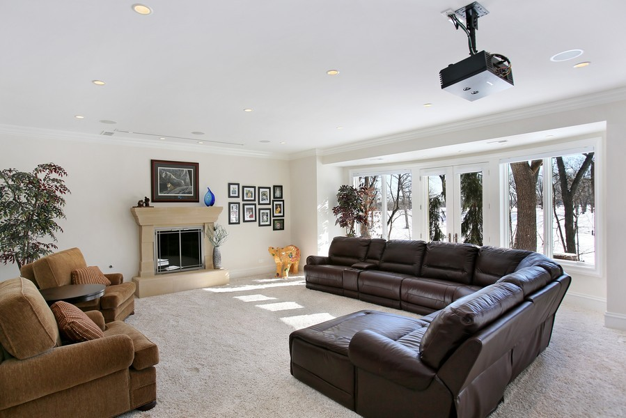 Real Estate Photography - 19 Baybrook Ln, Oak Brook, IL, 60523 - Lower Level Walk-out Family Room