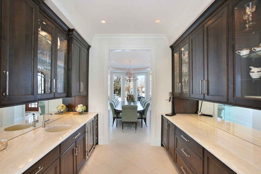 Real Estate Photography - 19 Baybrook Ln, Oak Brook, IL, 60523 - Butler Pantery Opens to Formal Dining Room