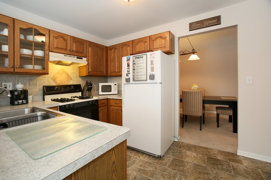 Real Estate Photography - 2247 Petworth Ct, 202D, Naperville, IL, 60565 - Kitchen