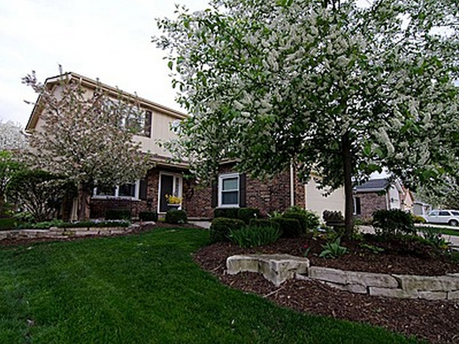 Real Estate Photography - 820 Morningside Dr, Naperville, IL, 60563 - Front View in Spring