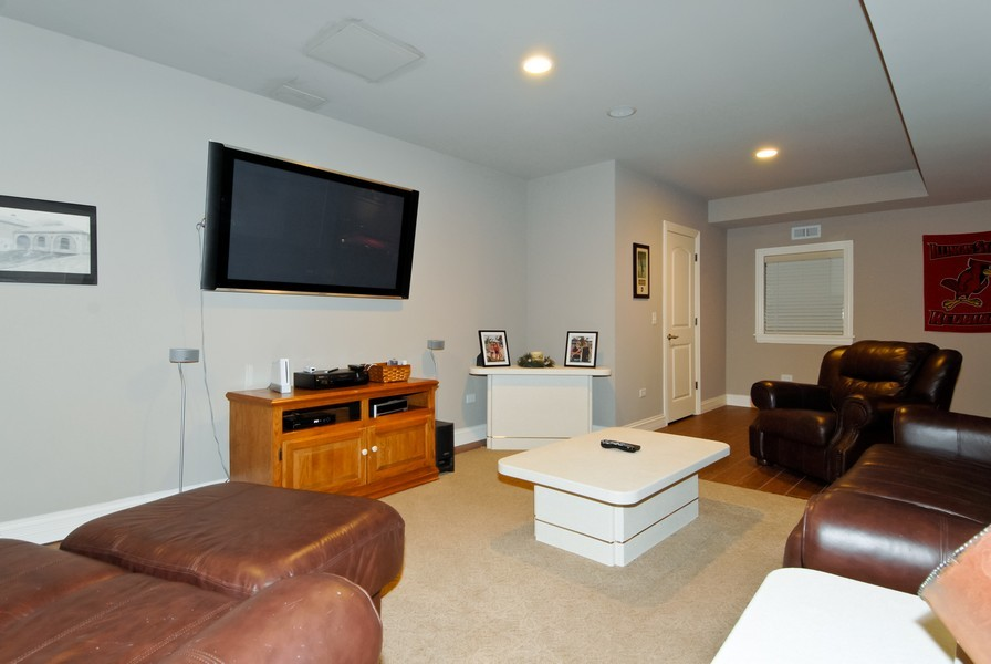 Real Estate Photography - 4164 Callery Rd, Naperville, IL, 60564 - Media Area in Basement - Tall Ceilings throughout!