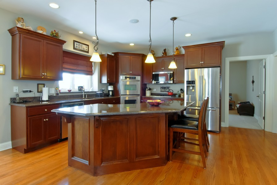 Real Estate Photography - 4164 Callery Rd, Naperville, IL, 60564 - Custom Cabinets/Lighting, Granite, Island Bar Seat