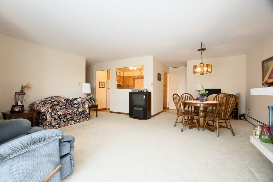 Real Estate Photography - 4250 Saratoga Ave, 202, Downers Grove, IL, 60515 - Living Room / Dining Room