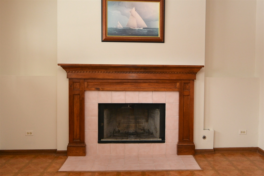 Real Estate Photography - 506 Pinecreek Dr, North Aurora, IL, 60542 - Woodburning Fireplace