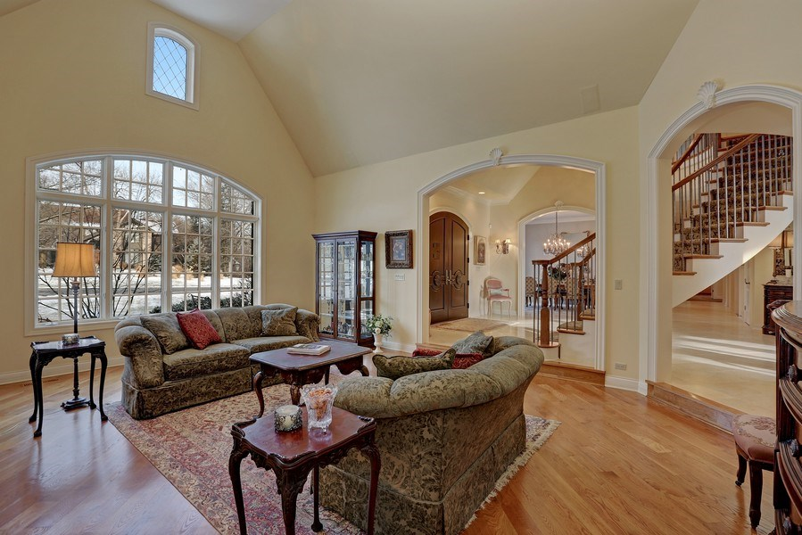 Real Estate Photography - 8S223 Derby Dr, Naperville, IL, 60540 - Living room with hand crafted limestone fireplace,