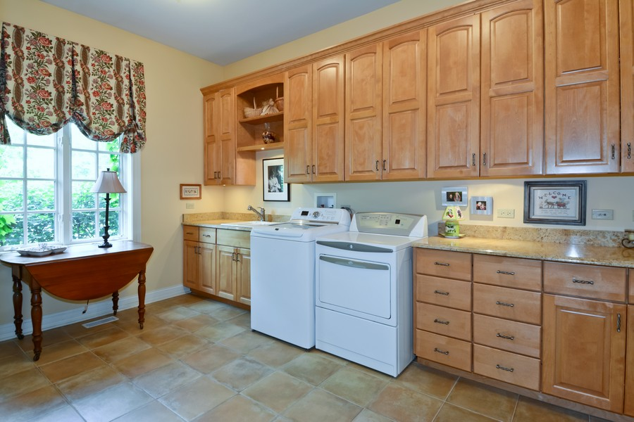 Real Estate Photography - 8S223 Derby Dr, Naperville, IL, 60540 - Main laundry, home has add'l laundry on 2nd floor