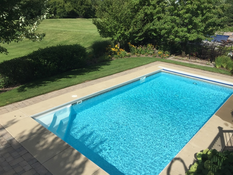 Real Estate Photography - 615 Papermill Hill Dr, Batavia, IL, 60510 - In-ground pool with a fenced in yard