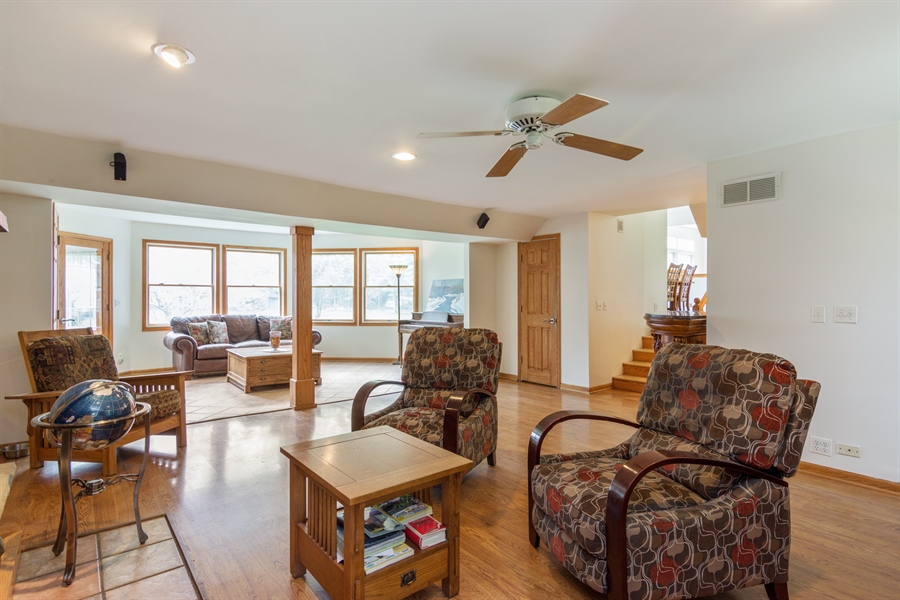 Real Estate Photography - 26166 N. Orchard Road, North Barrington, IL, 60010 - Living Room / Family Room with Powder Rm