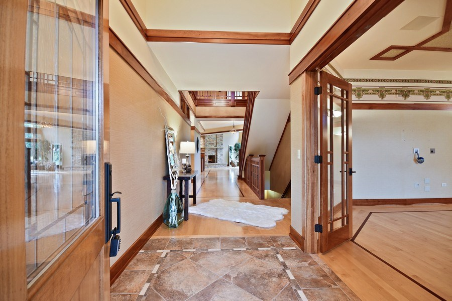 Real Estate Photography - 625 Bowling Green Court, Naperville, IL, 60563 - Welcoming foyer-note the cherry banding & trim