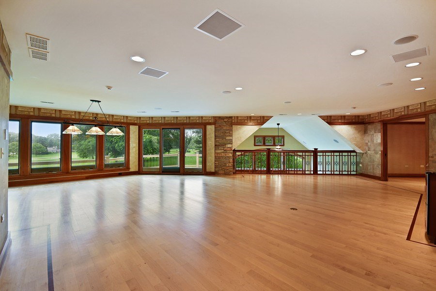 Real Estate Photography - 625 Bowling Green Court, Naperville, IL, 60563 - The 2nd floor rec rm walks out to the sun deck
