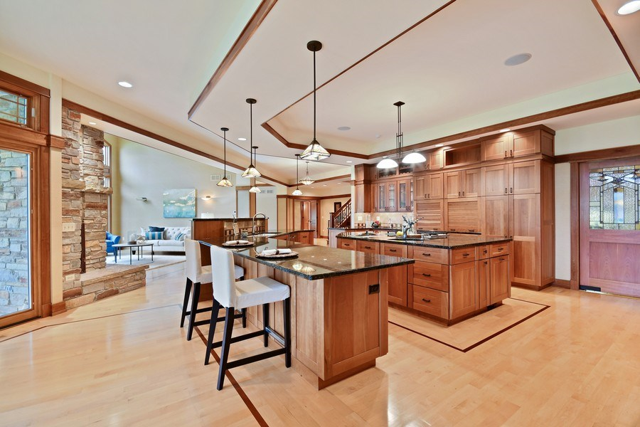 Real Estate Photography - 625 Bowling Green Court, Naperville, IL, 60563 - Open gourmet kitchen is the center of this home