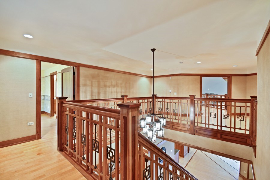 Real Estate Photography - 625 Bowling Green Court, Naperville, IL, 60563 - Upper hallway shows the intricate detail
