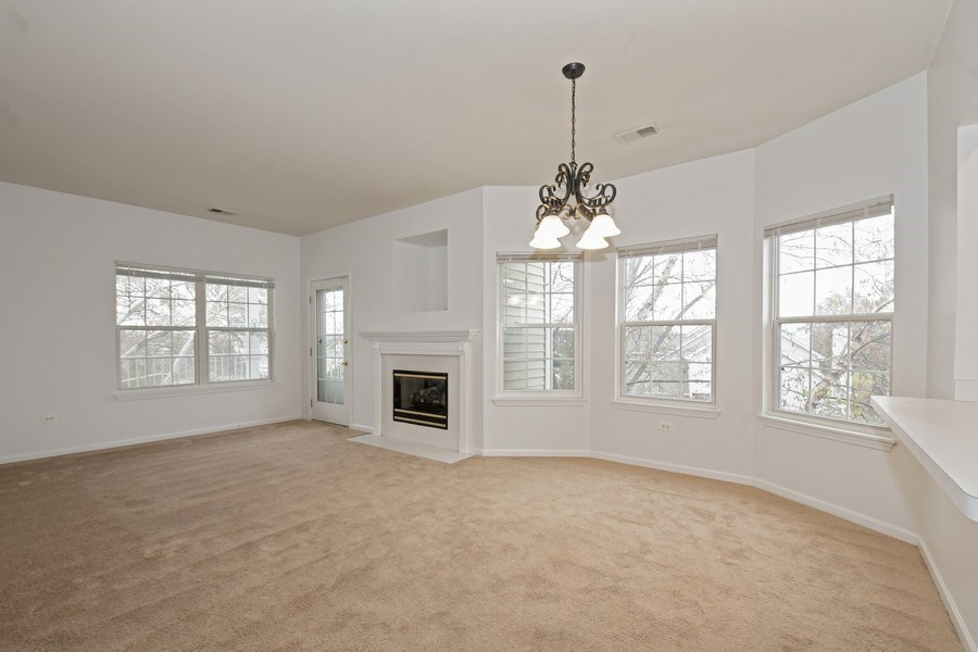 Real Estate Photography - 3243 Stratford Court, Unit 3F, Lake Bluff, IL, 60044 - Living Room / Dining Room