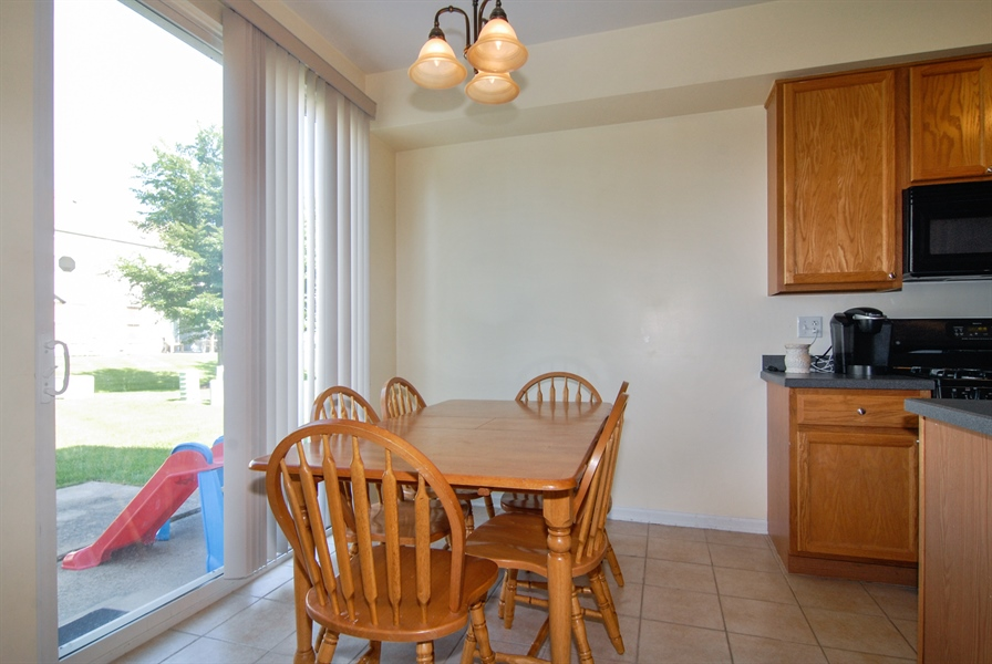 Real Estate Photography - 24831 Gates Court, Unit 24831, Plainfield, IL, 60585 - Dining Room