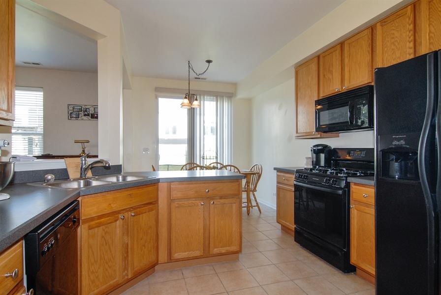 Real Estate Photography - 24831 Gates Court, Unit 24831, Plainfield, IL, 60585 - Kitchen