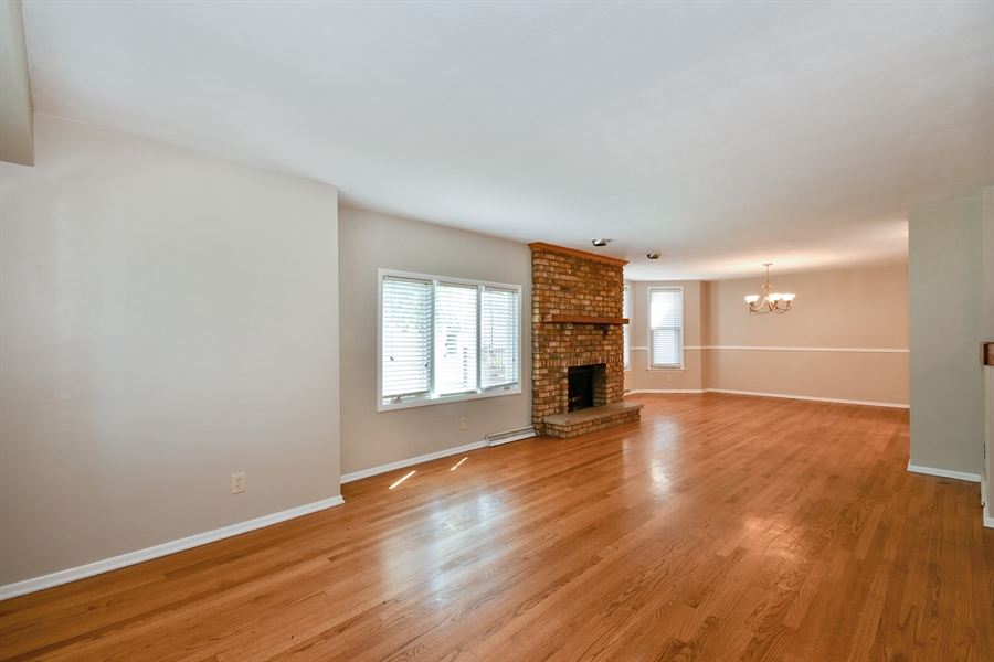 Real Estate Photography - 128 Richards Street, Geneva, IL, 60134 - Open Living Room-Dining Room w refinished Hardwood