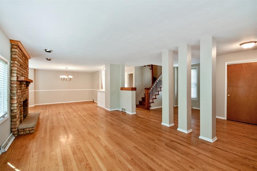 Real Estate Photography - 128 Richards Street, Geneva, IL, 60134 - Open layout with hardwood, fresh decor