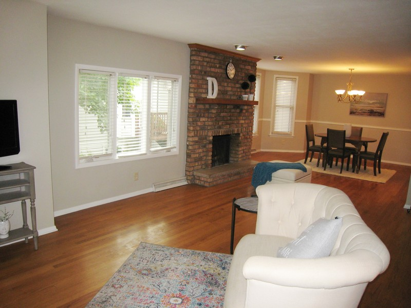 Real Estate Photography - 128 Richards Street, Geneva, IL, 60134 - Living room with fireplace, open to dining room