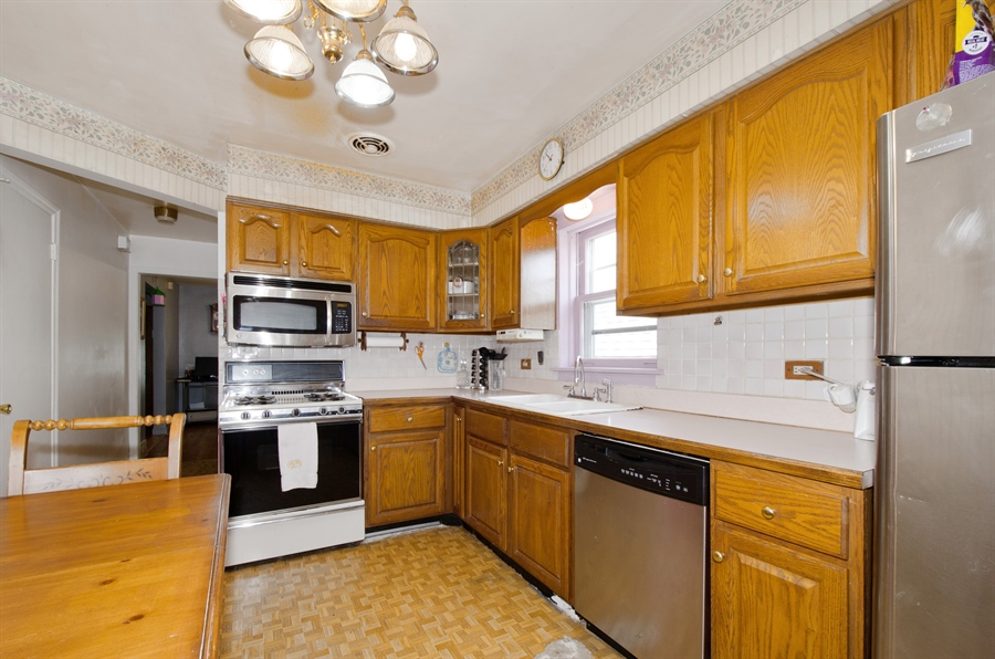 Real Estate Photography - 4715 N. Oconto Avenue, Harwood Heights, IL, 60706 - Kitchen