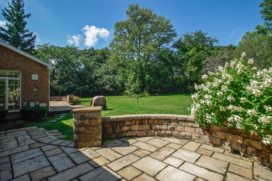 Real Estate Photography - 712 Milton Road, Inverness, IL, 60067 - Paver Patio and Seat Wall