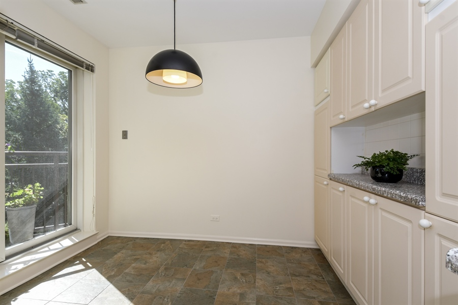 Real Estate Photography - 2601 Central St, 301, Evanston, IL, 60201 - Kitchen Breakfast Area with Balcony View