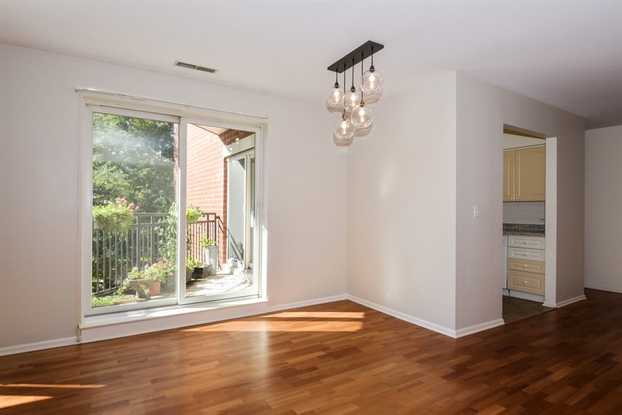 Real Estate Photography - 2601 Central St, 301, Evanston, IL, 60201 - Sliders to Balcony