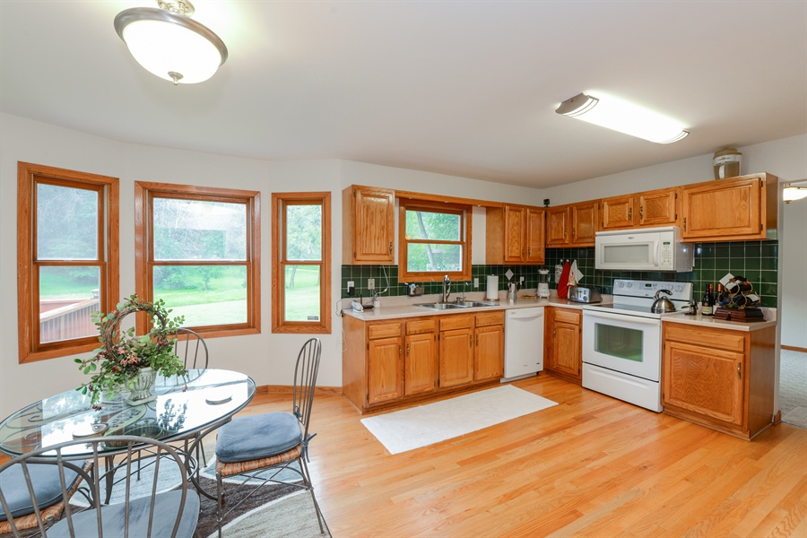 Real Estate Photography - 5695 S. Park Place Drive, Rochelle, IL, 61068 - Kitchen/Dining