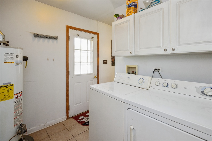 Real Estate Photography - 719 Rogers Road, Romeoville, IL, 60446 - Laundry Room