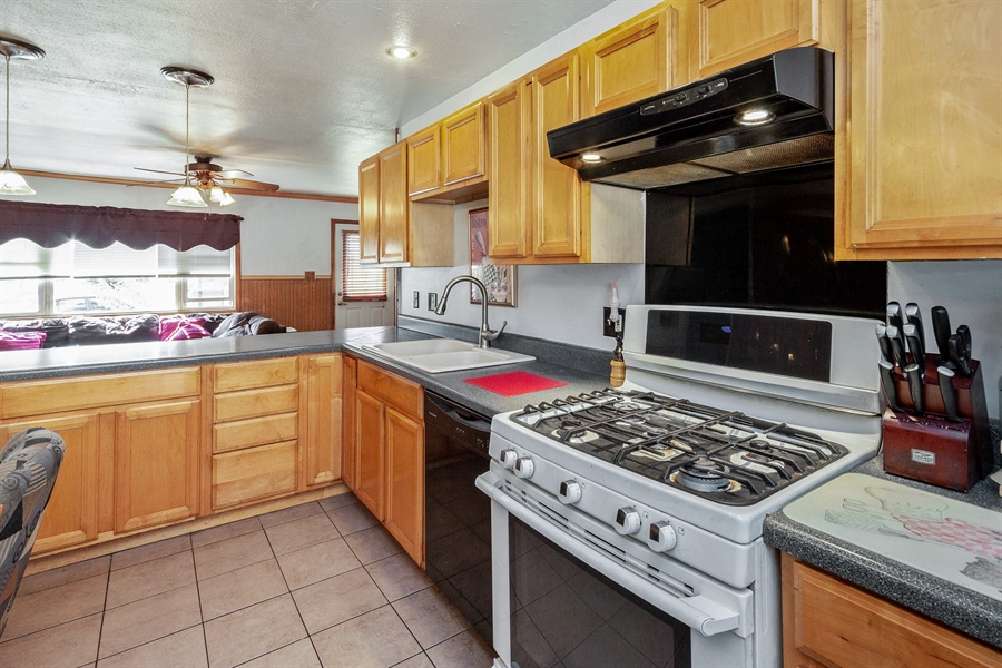Real Estate Photography - 719 Rogers Road, Romeoville, IL, 60446 - Kitchen