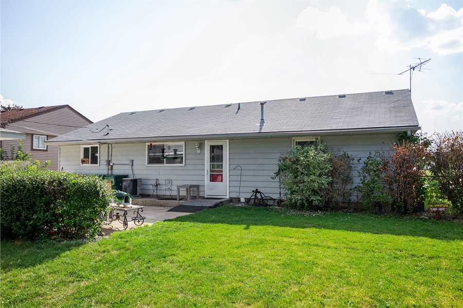 Real Estate Photography - 719 Rogers Road, Romeoville, IL, 60446 - Rear View