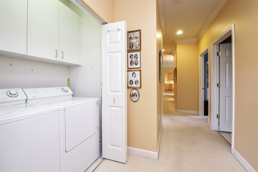 Real Estate Photography - 1875 Old Willow Road, Unit 113, Northfield, IL, 60093 - Laundry Room