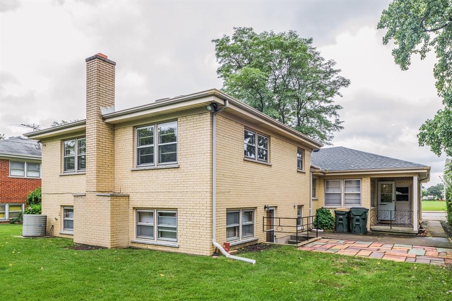 Real Estate Photography - 4618 W. Devon Avenue, Lincolnwood, IL, 60712 - Rear View