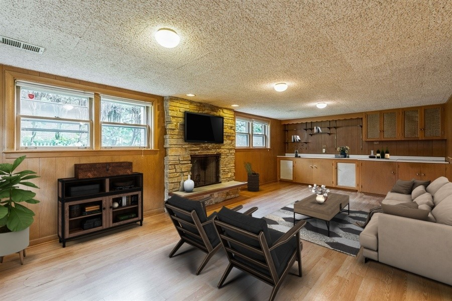 Real Estate Photography - 4618 W. Devon Avenue, Lincolnwood, IL, 60712 - Family room Staged