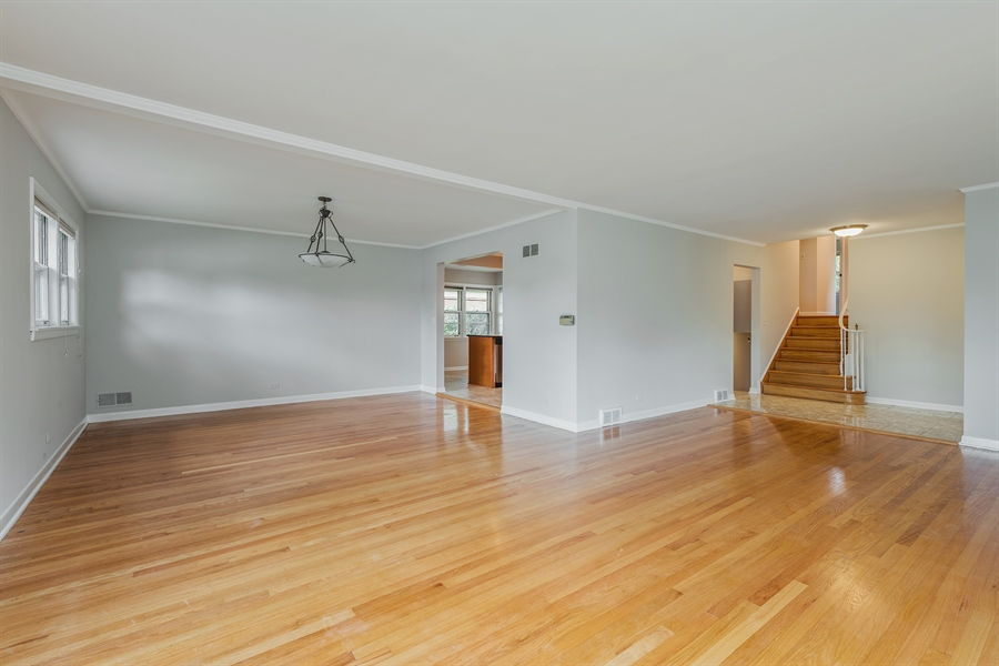 Real Estate Photography - 4618 W. Devon Avenue, Lincolnwood, IL, 60712 - Living Room / Dining Room