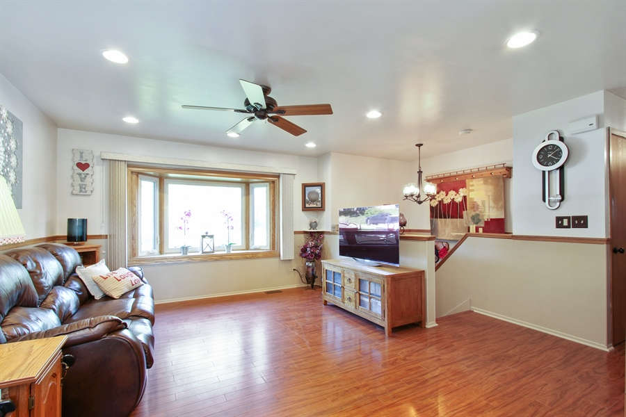 Real Estate Photography - 220 Briar Lane, Lindenhurst, IL, 60046 - BRIGHT, OPEN, LR W/LAMINATE FLOOR & OPEN ENTRY