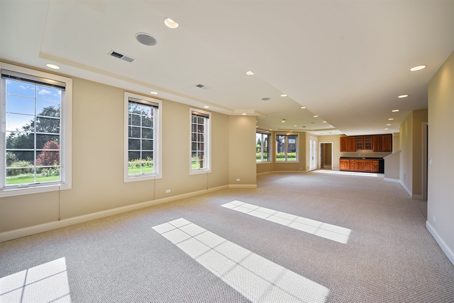 Real Estate Photography - 22220 N. PRAIRIE Lane, Kildeer, IL, 60047 - Walk out Lower level recreation room