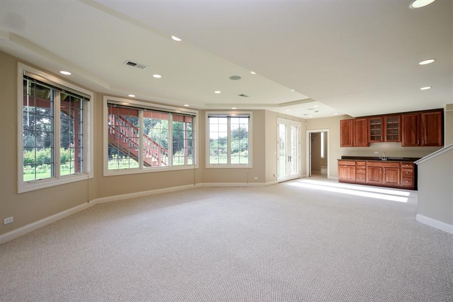 Real Estate Photography - 22220 N. PRAIRIE Lane, Kildeer, IL, 60047 - Walk out Lower level recreation room & wet bar