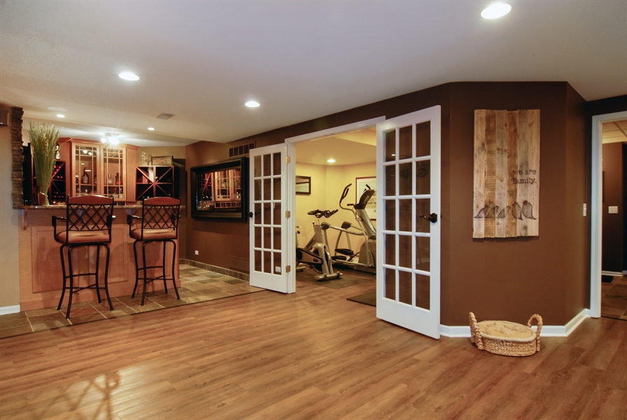 Real Estate Photography - 1090 Chadwick Court, Aurora, IL, 60502 - Basement-Bar and Exercise Room