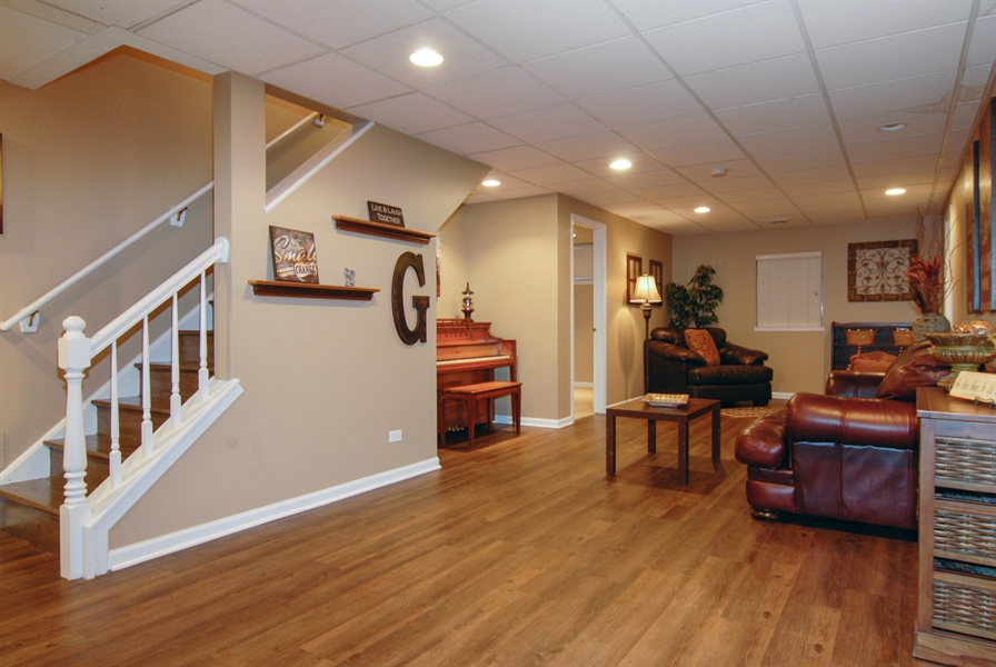 Real Estate Photography - 1090 Chadwick Court, Aurora, IL, 60502 - Basement Recreation Room