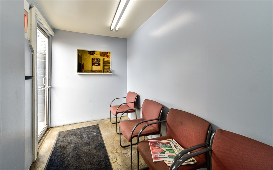 Real Estate Photography - 6321 West Roosevelt Rd, Berwyn, IL, 60402 - Sitting Room
