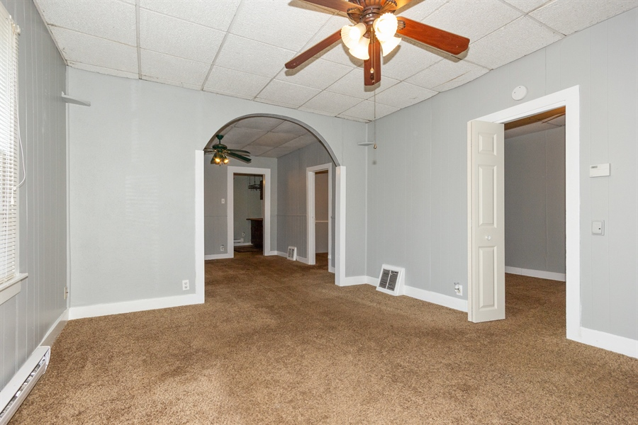 Real Estate Photography - 127 LAUREL Street, Wilmington, IL, 60481 - Guest House Living Room & Dining Room