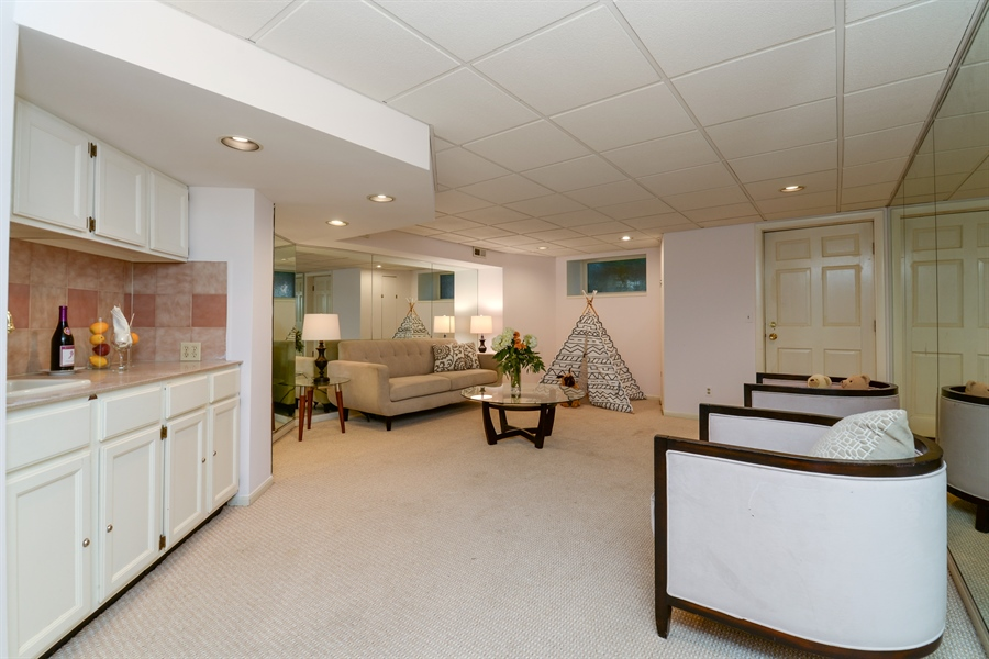 Real Estate Photography - 639 West Surf St, Chicago, IL, 60657 - Lower Level Family Room