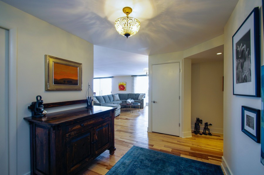 Real Estate Photography - 6007 N. Sheridan Road, Unit 38DF, Chicago, IL, 60660 - Foyer/Living Room