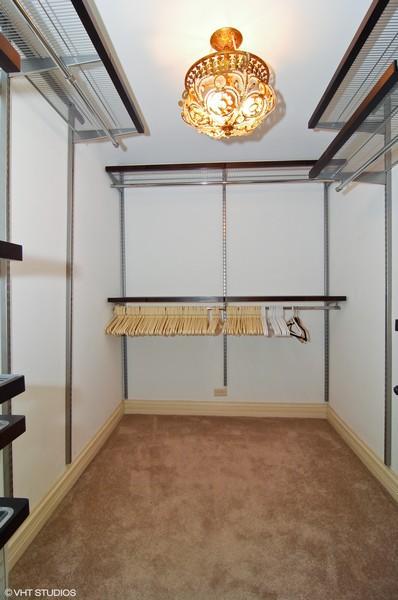 Real Estate Photography - 180 E Pearson, Unit 5501, Chicago, IL, 60611 - Master Walk-In Closet
